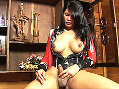 Shemale unwraps her latex covered cock