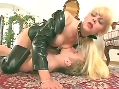 Shemale in boots deep fucks slave
